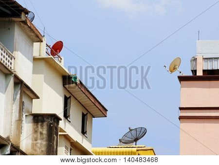 Satellite dishes on city home and buildings to get media signal
