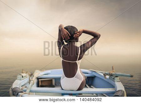Elegant woman sitting in a little boat