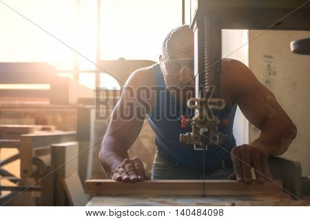 Artisan working on a piece of furniture