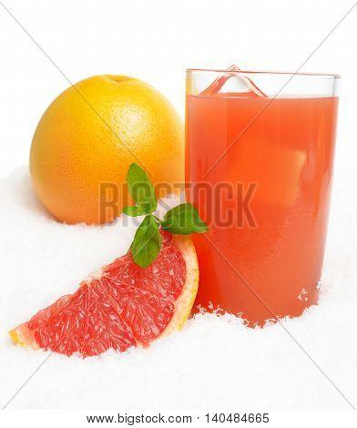 Grapefruit Juice,ice Cubes With Halved Grapefruit On Ice On White