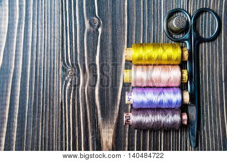 Accessories For Sewing On Dark Wooden Table