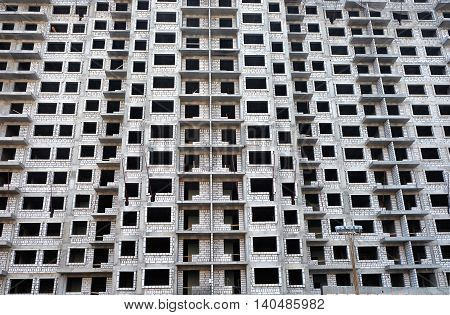 Front view of high-rise modern apartment building construction in process front view horizontal