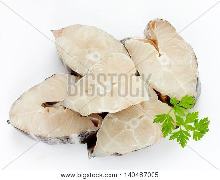 Pieces of fish isolated on white background top view