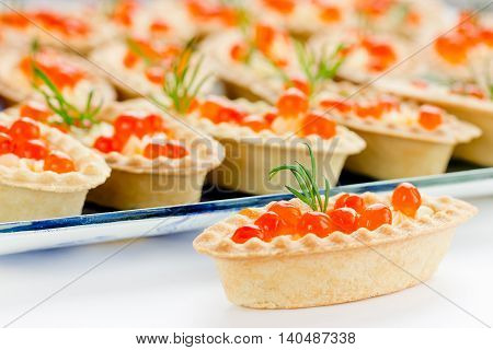 Tartlets with red caviar. Cocktail party snacks with red caviar gourmet food festive appetizer