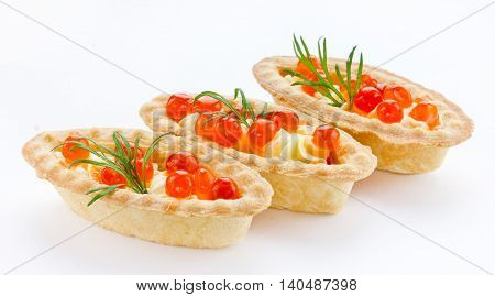 Tartlet with red caviar close up isolated on white background. Cocktail party snacks with red caviar gourmet food festive appetizer sample serving