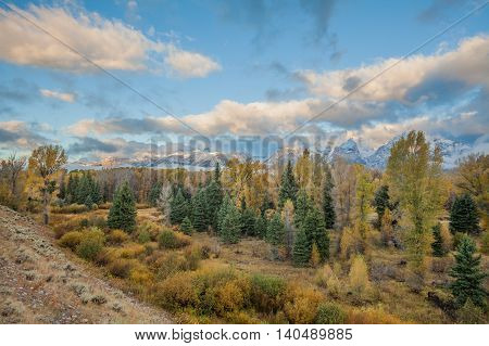the scenic landscape of the tetons in autumn