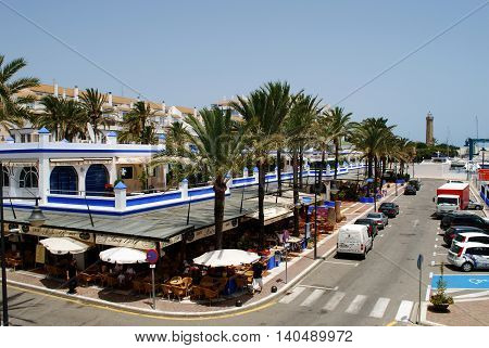 ESTEPONA, SPAIN - JULY 18, 2008 - Elevated view of the harbour buildings and cafes Estepona Malaga Province Andalusia Spain Western Europe, July 18, 2008.