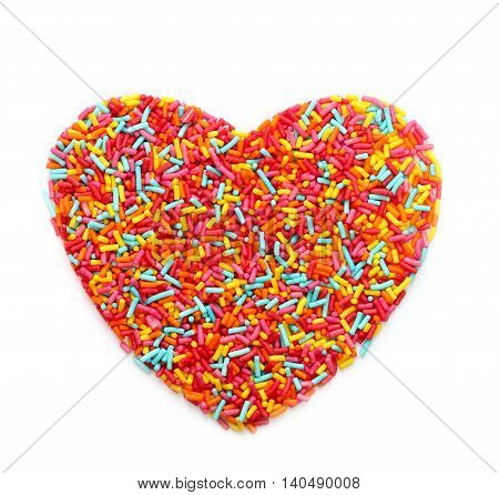 Sugar sprinkles shaped heart isolated on white background