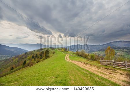 Trail in the countryside and mountains in the background. Carpathians