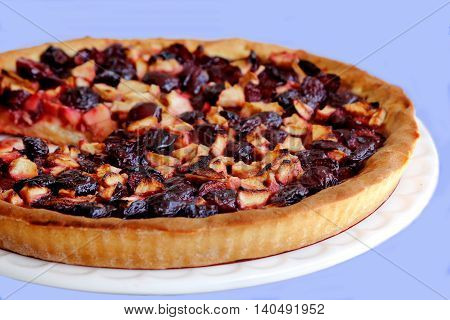 a plate freshly baked apple pie plums
