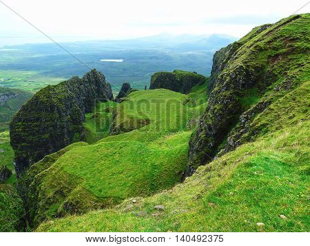 Green rocky hills of the Isle of Skye in Scotland.