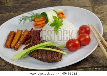 roast fillet duck with rice on white plate