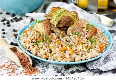Devzira pilaf with lamb and spices traditional Uzbek cuisine selective focus