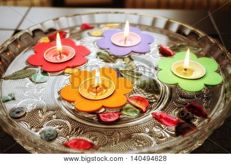floating little candles in glass water bowl.