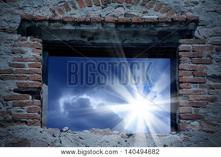 conceptual image of sun rays and building window