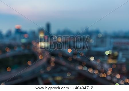 Abstract blurred lights night view, city and highway interchanged, at twilight