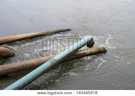 Waste water flow from water pipe into lake