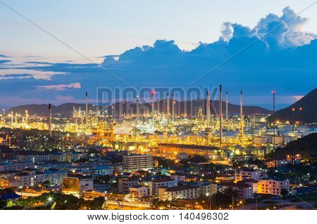 Oil Refinery factory mountain background at twilight, petrochemical plant