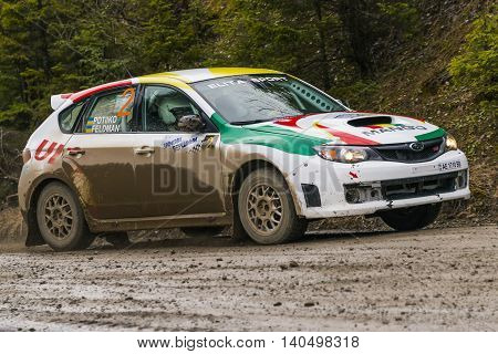 Nyzni Worota Ukraine - March 13 2016: Unknown racer on the car brand Subaru Impreza WRX (No.2) overcome the track at the annual Rally of Winter peaks near the city of Nyzni Worota Ukraine