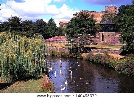 TAMWORTH, UK - AUGUST 9, 1995 - View of the Norman castle with swans on the River Anker Tamworth Staffordshire England UK Western Europe, August 9, 1995.