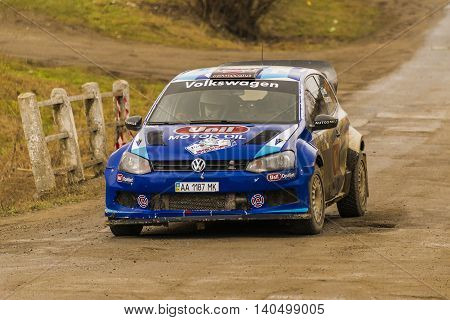 Nyzni Worota Ukraine - March 13 2016: Unknown racer on the car brand Volkswagen Polo Concept (No.5) overcome the track at the annual Rally of Winter peaks near the city of Nyzni Worota Ukraine