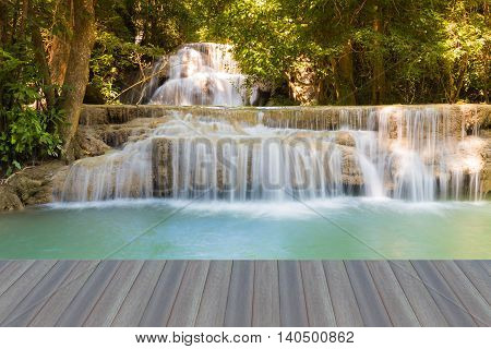 Opening wooden floor, Waterfall in deep tropical forest in Thailand natural park