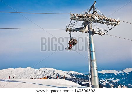 Ski chair lift moving, rope way in Alps mountains in Mayerhofen, Austria