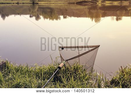 On the banks of the river lowered into the water great convenient the net for caught fish.