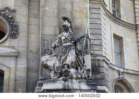 PARIS, FRANCE - MAY 12. 2015: This is statue of the goddess Athena at the entrance of Les Invalides.