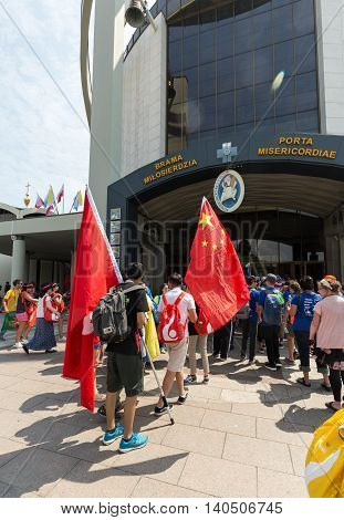CRACOW POLAND - JULY 26 2016: World Youth Day 2016 - Pilgrims from China come across Door of Mercy in the Sanctuary of Divine Mercy in Lagiewniki. Cracow Poland