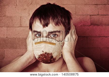 Young Teen Boy Wearing Blood Soaked Surgical Mask