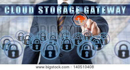 Corporate manager is pushing CLOUD STORAGE GATEWAY on a virtual control monitor. Business metaphor. Emerging technologies concept involving cloud storage encryption and data security.