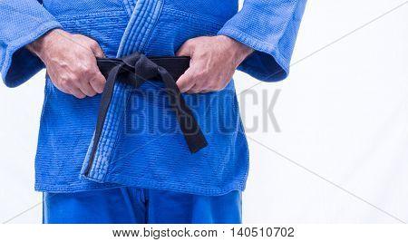 Close up of judo judo-gi and belt isolated on white background