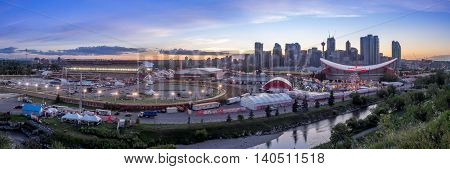 CALGARY, CANADA - JULY 8: Panoramic view of the the Calgary Stampede at sunset on July 8, 2016 in Calgary, Alberta. The Calgary Stampede is often called the greatest outdoor show on Earth.