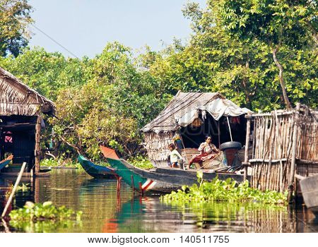 SIEM REAP, CAMBODIA-NOVEMBER 17, 2011: people of village on the water of Tonlesap lake. Cambodia