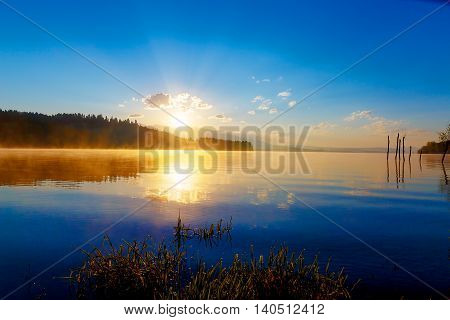 beautiful landscape with mountains and lake at dawn in golden, blue and purple tones. Slovakia, Central Europe, region Liptov