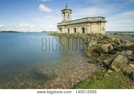 An image of the Beautiful Normanton Church in the morning sun, shot at Rutland Water Rutland England UK. Long exposure using ND filter.