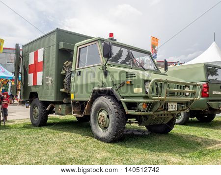 CALGARY, CANADA - JULY 9: Military ambulance exhibit at the the Calgary Stampede midway on July 9, 2016 in Calgary, Alberta. The Calgary Stampede is often called the greatest outdoor show on Earth.
