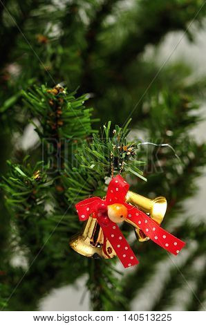 Bells tied with a red bow to decorate a Christmas tree