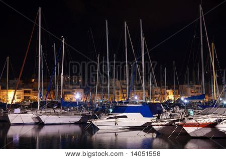 Yachts Lying At  Harbour In  Night