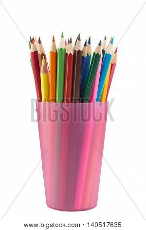 Many drawing pencils in a pink transparent cup isolated on white