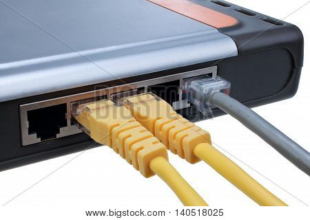 Network hub with plugged ethernet cables LAN isolated on white background with clipping path