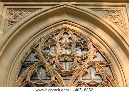 Old window of imperial stables in the style of English Gothic near St.Petersburg Russia.