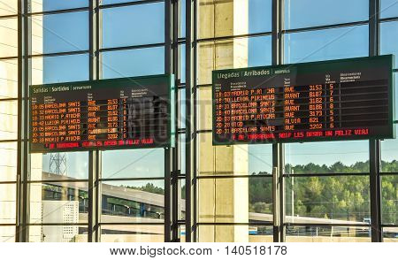 Schedule boards at railway station. Camp de Tarragona Spain. Horizontal.