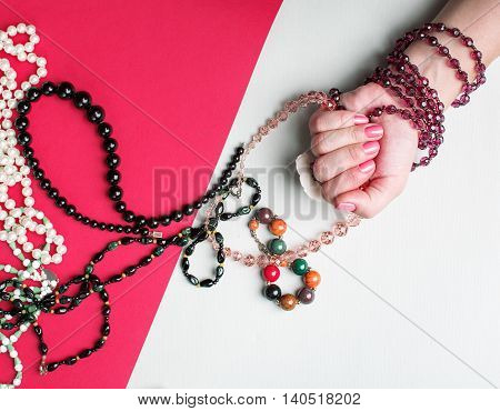 women's bijouterie. girl holding a colored beads