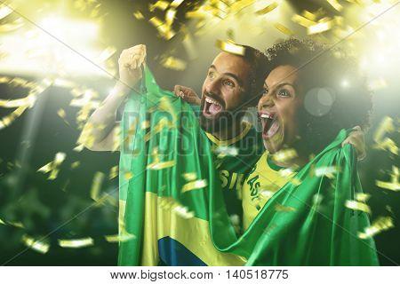Brazilian couple fan celebrating in the stadium