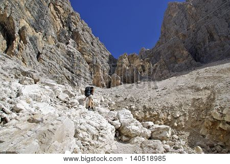 Hiker in the Dolomites Cristallo Group, Italy