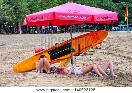 Bali,Indonesia-May 28,2010:Tourists relaxing and enjoying on the beach at Kuta beach,Bali,Indonesia. Bali is a popular holiday destination especially for young and backpackers.