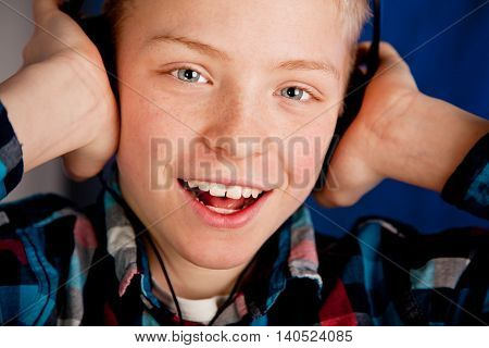Happy Young Teenage Boy Wearing Headphones