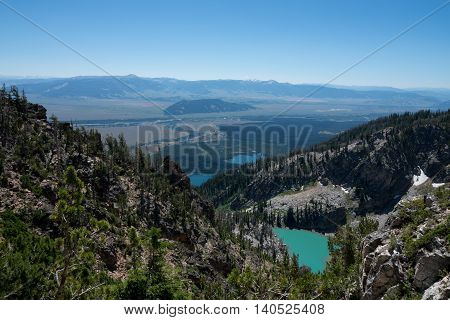 The view of the valley below from the upper elevation of the Grand Teton National Park in Wyoming.